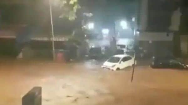 A Hyundai Xcent is seen swept away in rain in Mumbai. (Image: Twitter/ANI)