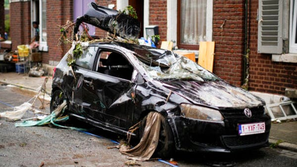 A car is strewn with debris in a residential street after flooding in Ensival, Verviers, Belgium. Close to 200 people have lost their lives in Belgium and Germany due to flooding-related factors. (AP)