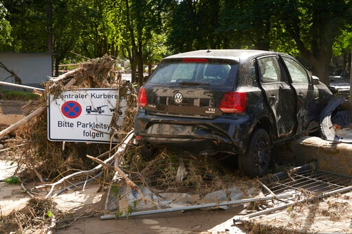 A car destroyed after extreme weather in Bad Neuenahr-Ahrweiler, Germany, Days of heavy rain in Western Europe turned normally minor rivers and streets into raging torrents that swept away cars, engulfed homes and trapped residents. (AP)