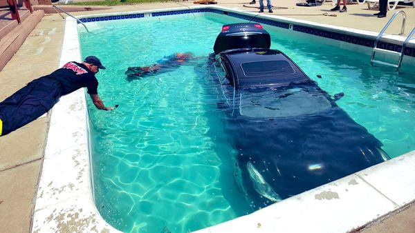 An Infiniti G37X luxury sedan was accidentally driven into the pool by a teenager who escaped unhurt in the incident that took place in Colorado, United States. (Photo courtesy: Twitter/@LakewoodPDCO)