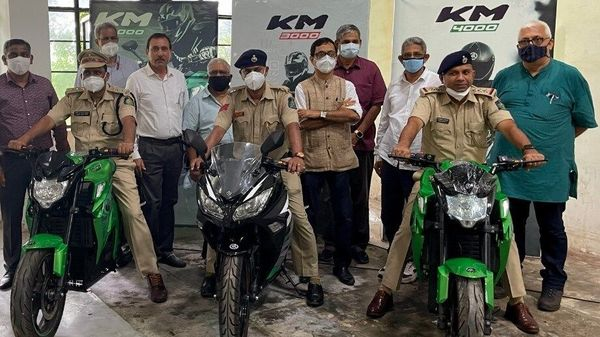 Goa Police personnel pose with the KM3000 and KM4000 electric bikes from Kabira Mobility.