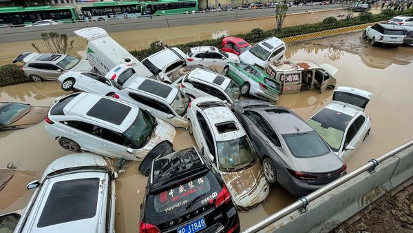 Cars sit in floodwaters after heavy rains hit the city of Zhengzhou in China's central Henan province on July 21, 2021. (AFP)