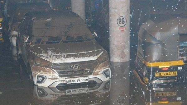 Cars, bikes and three-wheelers are seen submerged in the rainwater at an underground parking lot near Mumbai. (HT PHOTO)