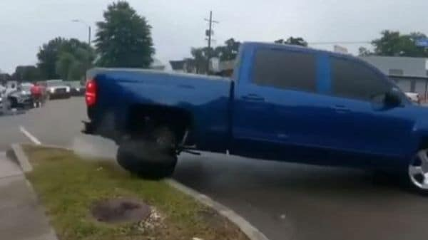 Clock: Chevrolet Silverado truck trying to fall on donuts on the sidewalk