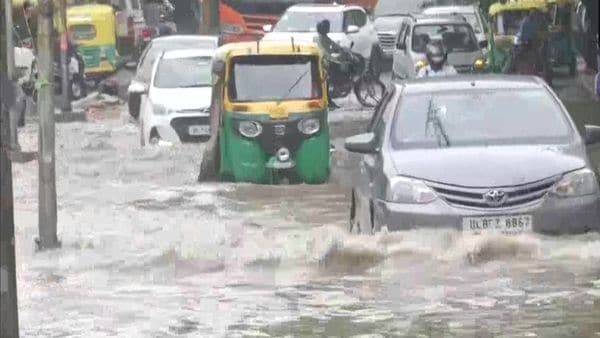A waterlogged stretch in South Delhi's Alaknanda area amid heavy rainfall in Delhi caused vehicular movement to slow down, leading to traffic snarls. (ANI)