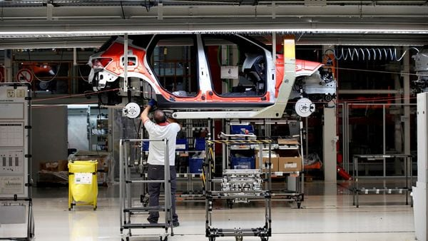 FILE PHOTO: Workers assemble vehicles on the assembly line of a car factory. (Photo used for representational purpose only) (REUTERS)