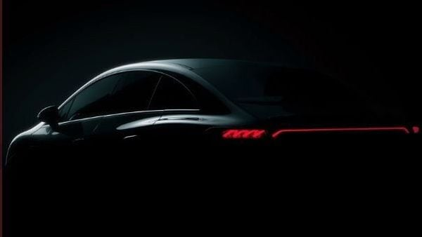 The stretched out light between the tail lights of the EQE is seen in this teaser image of the EV.