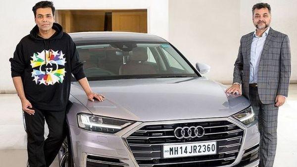 Film director Karan Johar (L) and Audi India Head Balbir Dhillon (R) pose with the former's Audi A8 L. (audiin/Instagram)