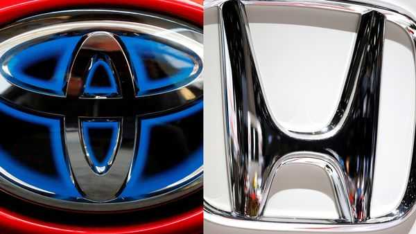 Logos of Toyota (L) and Honda (R)
