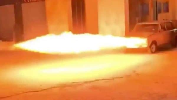 The little sedan's outer headlight bezels turn into jets of flame. (Image: Reddit/BeAmazed)