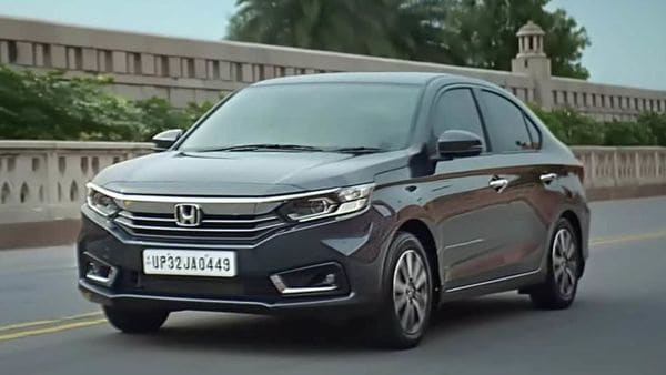 Honda has launched the 2021 Amaze sub-compact sedan for the Indian market priced between <span class='webrupee'>₹</span>6.32 lakh and <span class='webrupee'>₹</span>11.15 lakh (ex-showroom). The updated sedan comes with a redesigned exterior and cosmetic changes inside the cabin.