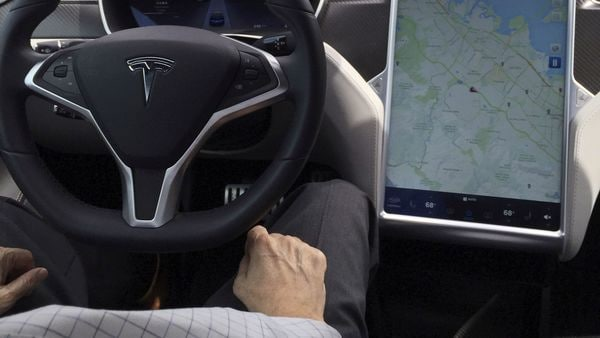 FILE PHOTO: The interior of a Tesla Model S is shown in autopilot mode in San Francisco, California, US. (REUTERS)