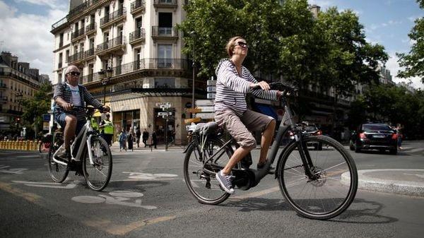A woman rides an electric bike in Paris, France. (Representational File Photo) (REUTERS)