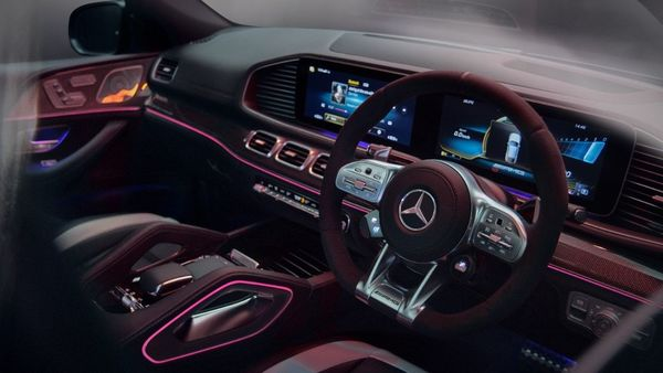 The three-spoke AMG Performance steering wheel inside the SUV is wrapped in full DINAMICA micro-fiber and is complimented with aluminium shift paddles.