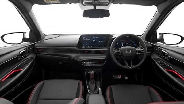On the inside, the Hyundai i20 N Line will get a 10.25-inch main infotainment screen and an all-digital instrument cluster. It will feature unique three-spoke steering design, chequered-flag leather seats with N Line logo, red interior highlights, red ambient light and metal pedals, among other highlights.