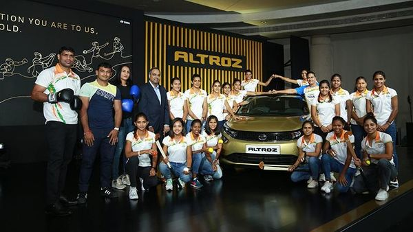 Indian Olympics athletes, including the women's hockey team which missed the Bronze by a whisker, being felicitated by Tata Motors with Altroz hatchback.