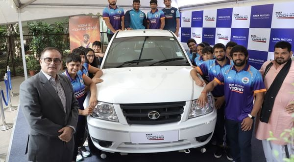 Tata Motors joins hand with Wrestling Federation of India to launch Quest for Gold at Paris Olympics 2024 programme.