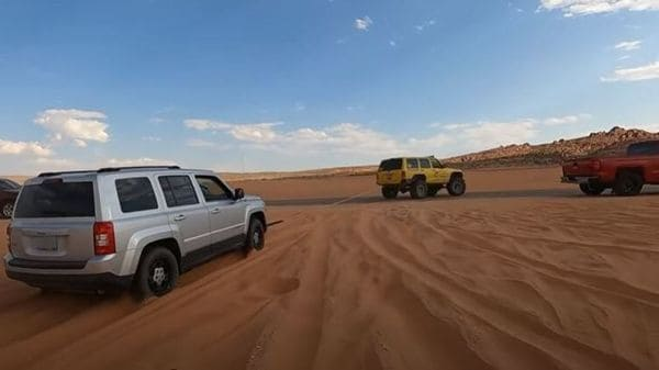 Rescue team from Matt's Off Road Recovery on sand rescue mission. (Image source: Screengrab of a video posted on YouTube by Matt's Off Road Recovery)