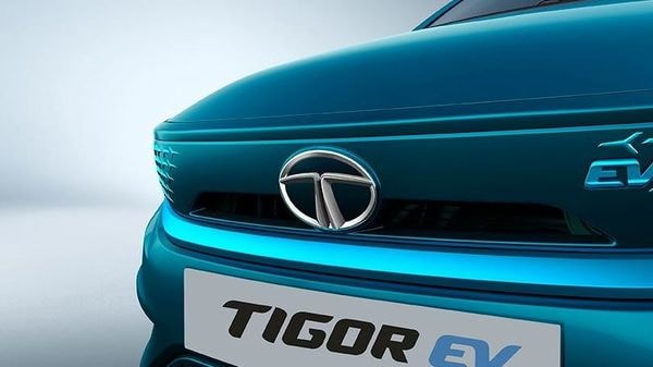 The EV will feature some new designs with projector head lights. The front grille and bumper design have been tweaked while the alloy wheels come with blue accents to underline the zero-emission character of the EV. (Tata Motors)
