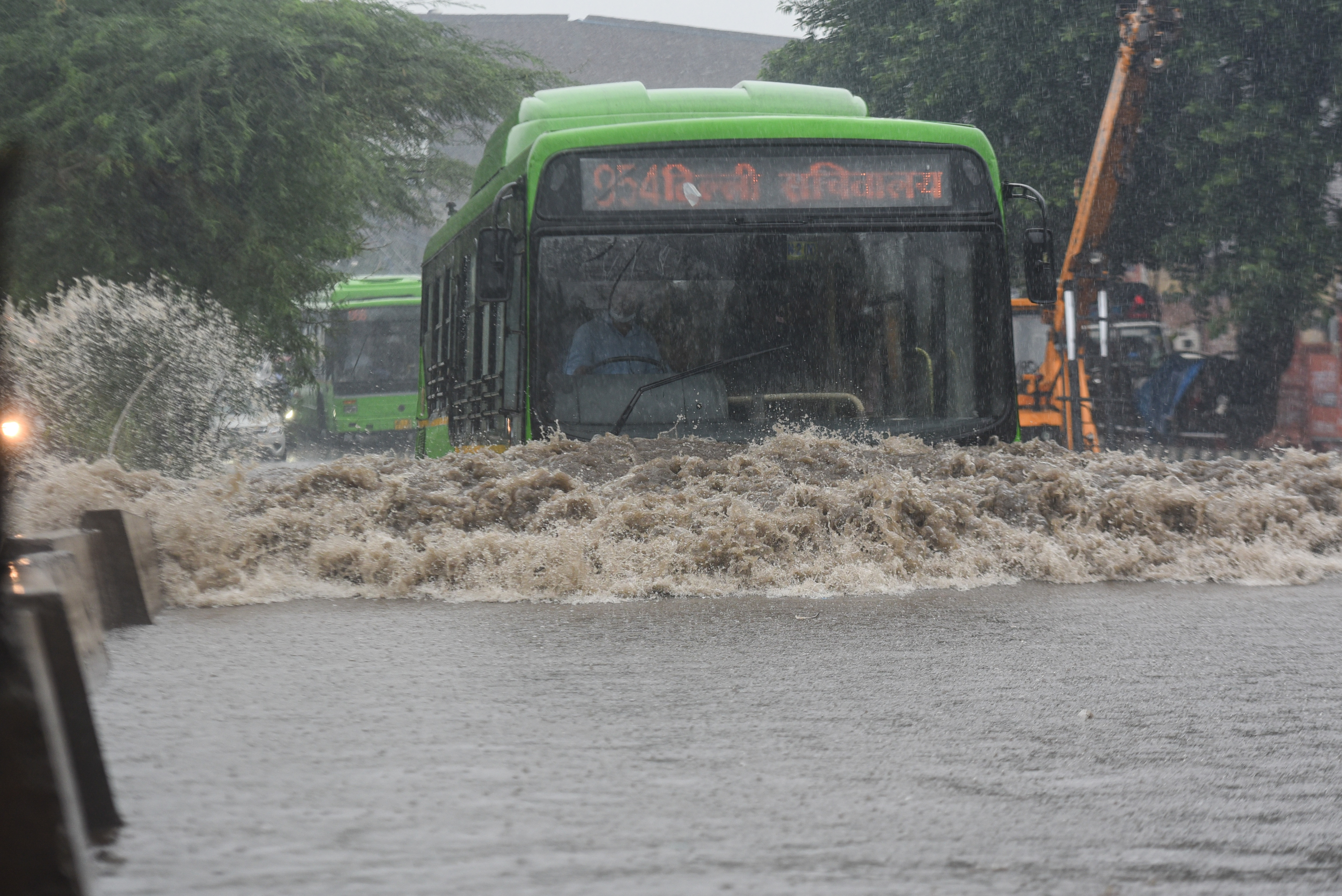 A DTC bus moves through a waterlogged road in Delhi's Anand Parbat. (Sanchit Khanna/HT PHOTO)