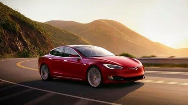 In China, Tesla shipped around 33,000 electric cars locally and to overseas markets in July. (AP)