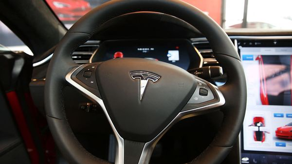 A new survey by Morning Consult reveals that the news about Tesla autopilot-related crashes has failed to reach majority of general public. (AFP)
