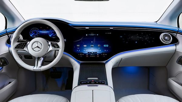 The MBUX-enabled Hyperscreen is the highlight of the interior of the new EQE sedan. It is a large, curved screen that contains three screens under a glass cover that makes it appear as one whole screen. The 12.3-inch OLED display for the front passenger will give them their own display and control area. (Daimler)