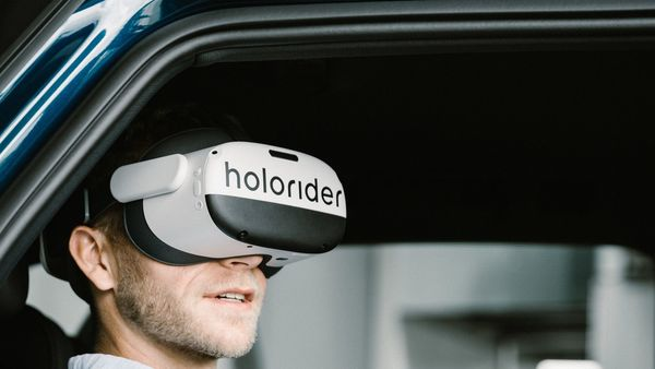 The real time merging of vehicle movement and VR content helps reduce car sickness among passengers.