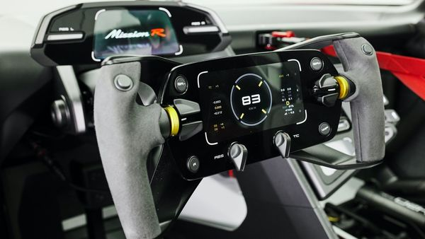 The controls on the steering wheel will show the driver relevant data during a race. The monitor above the steering column will show images from the side mirror cameras and the central rear-view mirror camera. A touch display located at the right of the seat can be used to get a driver's biometric data as well. Porsche has provided multiple cameras in the interior so that a user can go for a live stream transmission.