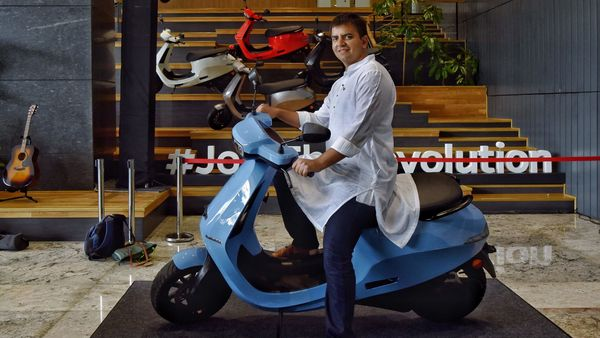 Bhavish Aggarwal, Ola Electric CEO, with the S1 Pro electric scooter. (AFP)
