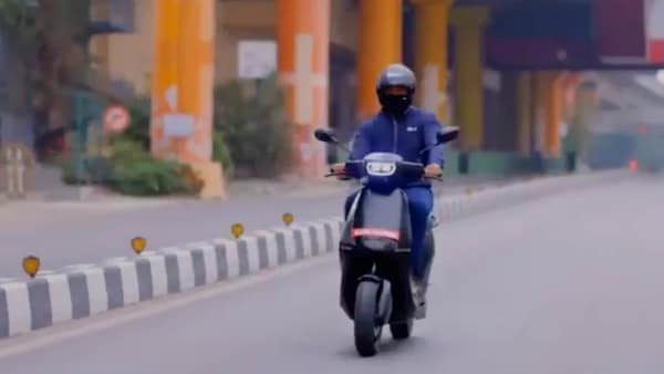 File photo of Ola Electric CEO Bhavish Aggarwal riding an e-scooter from his company.