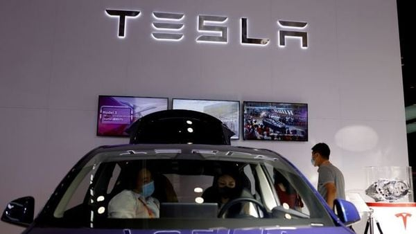 File photo: People check a Tesla Model Y electric vehicle (EV) displayed at its booth during the 2021 China International Fair for Trade in Services (CIFTIS) in Beijing, China. (REUTERS)