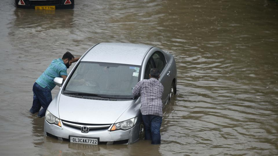 Waterlogging was witnessed on NH 48 near Gurugram/Parade Road Crossing and vehicles going from Dhaula Kuan to Gurugram were the worst affected. Traffic police advised commuters to avoid roads that were affected due to waterlogging. (HT_PRINT)