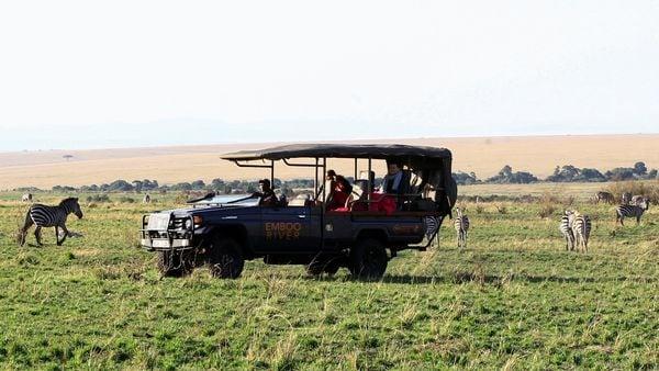 An electric-powered safari vehicle moves during a game drive safari at the Maasai Mara National Reserve in Narok County, Kenya. (REUTERS)
