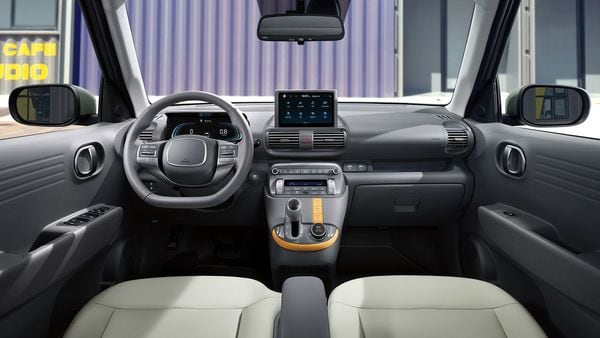 On the inside, Hyundai Casper gets a spacious cabin. It gets a grey-coloured interior theme, interspersed with beige and yellow. The steering wheel in Casper is flat-bottomed and come with mounted controls. The digital instrument cluster appears to be larger in size than the infotainment screen perched on top of the dashboard.