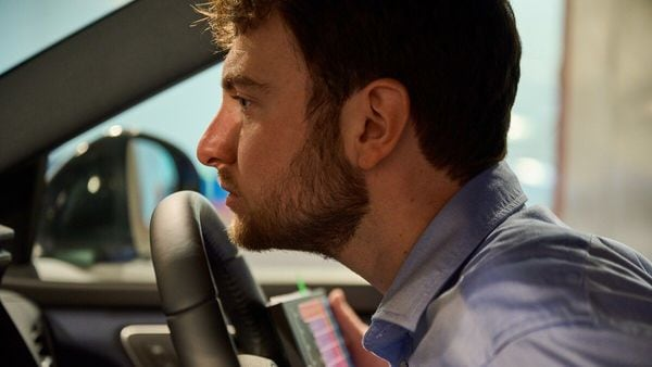 Peter Karl Eastland, Odour Evaluation Lead Engineer at Nissan takes a sniff of the cabin ambience of the all-new Nissan Qashqai.