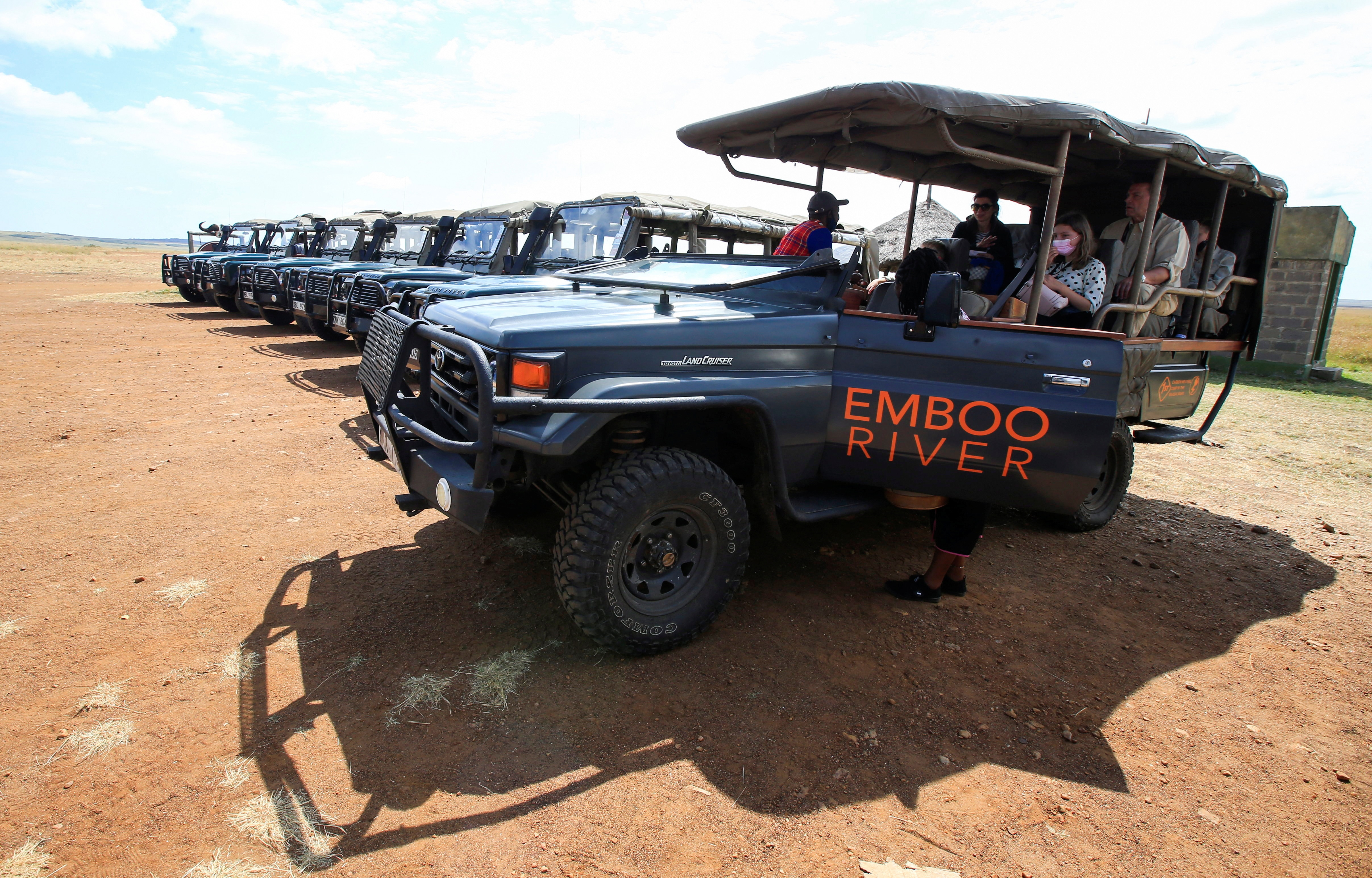 Electric-powered safari vehicle line up at the Maasai Mara National Reserve in Narok County, Kenya.
