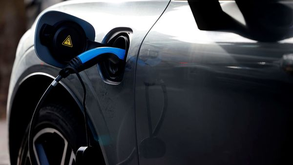 A charging cable is pictured plugged into a an electric vehicle (EV). (File photo used for representational purpose only) (AFP)