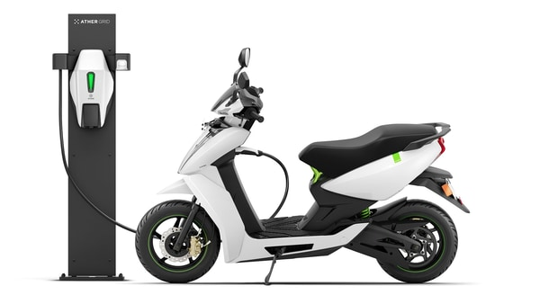 File photo of Ather 450X electric scooter along with Ather Grid fast-charging unit.