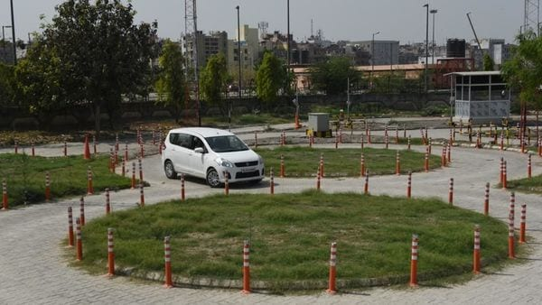 On the automated tracks for driving tests in Delhi, licencing officer oversees the test, then take a print-out of the result and sign it. (HT_PRINT)