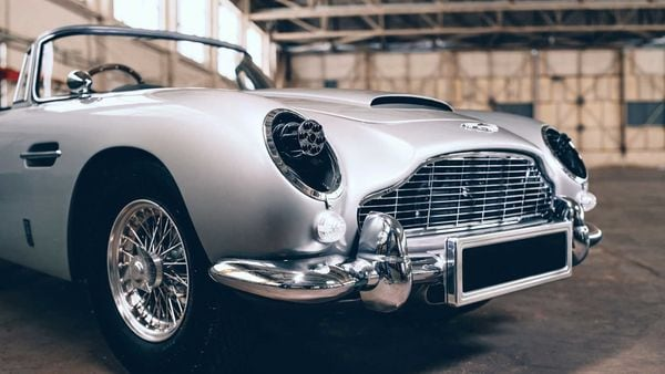Aston Martin DB 5 Junior No Time to Die edition features the brand's classic Silver Birch paintwork, Smiths instruments and badging.