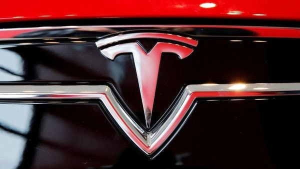 Tesla met NHTSA officials and claimed the fuel efficiency penalty rule be reinstated. (Reuters)