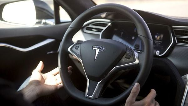 File photo: While Tesla urges drivers to pay attention to road conditions and surroundings at all times, many have been found guilty of doing anything but. (REUTERS)