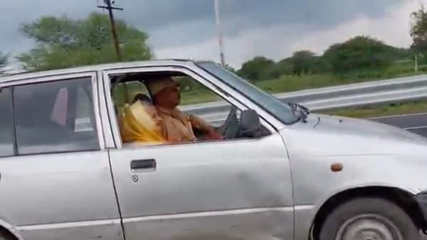 Resham Bai Tanwar, a 90-year-old woman from Dewas in Madhya Pradesh, seen honing her driving skills on an old Maruti 800 car. (Photo courtesy: Twitter/@SINGH_SANDEEP_)