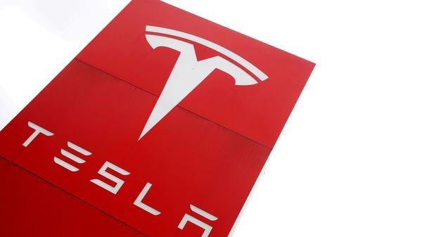 File photo: The logo of car manufacturer Tesla is seen at a dealership. (REUTERS)