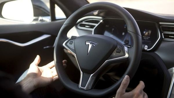 File photo: Main features of Tesla's FSD programme are its ability to automatically enable drivers to change lanes, navigate on highways, drive to a parking spot, among others. (REUTERS)