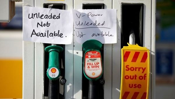 Hand-written signs are stuck to a petrol pump with no fuel available at a Shell filling station in Manchester. (REUTERS)