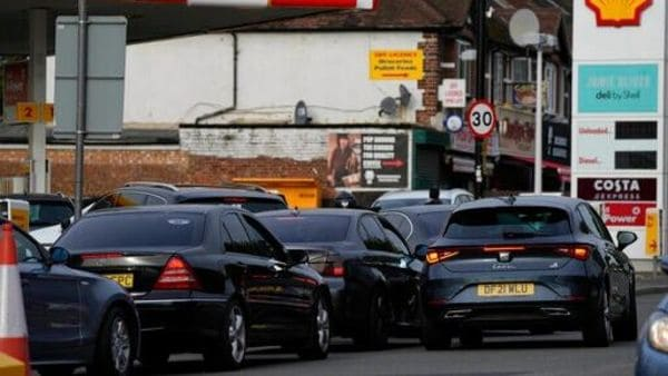 Drivers queue for fuel at a petrol station in London. Long lines of vehicles have formed at many gas stations around Britain since Friday, causing spillover traffic jams on busy roads. (AP)