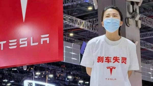 The Tesla Model 3 owner, wearing a t-shirt that reads Brake Lost Control, was dragged away from the venue and detained for five days for her protest during the Shanghai Auto Show. (File photo)