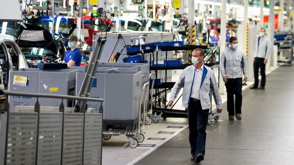 FILE PHOTO: Staff wear protective masks at the Volkswagen assembly line in Wolfsburg, Germany. (REUTERS)